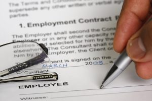 Employment contract signing concept - many uses for jobs and employment purpose.