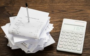 receipts with calculator on desk