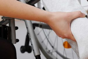 Man with leg in plaster in wheelchair